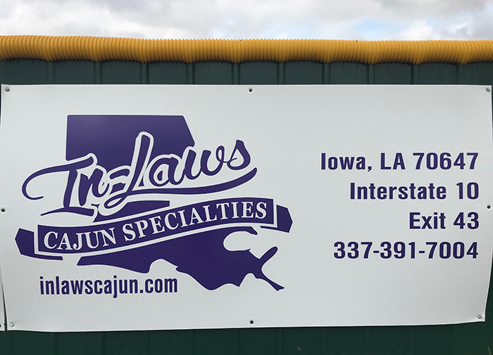 Softball Field Sign - InLaws Cajun Specialties - Banner hanging at Iowa High School, Louisiana